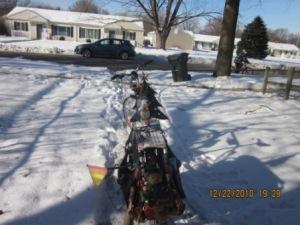 bike in snowy driveway